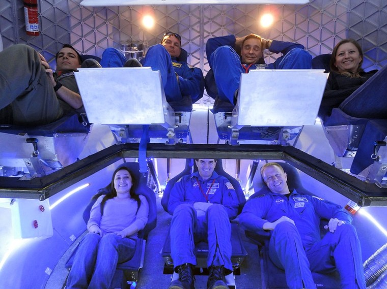 Image: ASA astronauts and industry experts check out the crew accommodations in SpaceX's Dragon spacecraft.