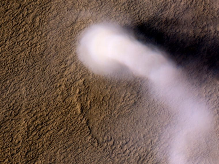 Image: A dust devil the size of a terrestrial tornado towers above the Martian surface