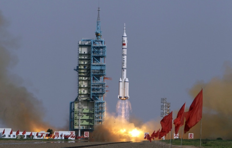Image: The Long March II-F rocket loaded with Shenzhou-9 manned spacecraft carrying Chinese astronauts Jing Haipeng, Liu Wang and Liu Yang lifts off from the launch pad in the Jiuquan Satellite Launch Center