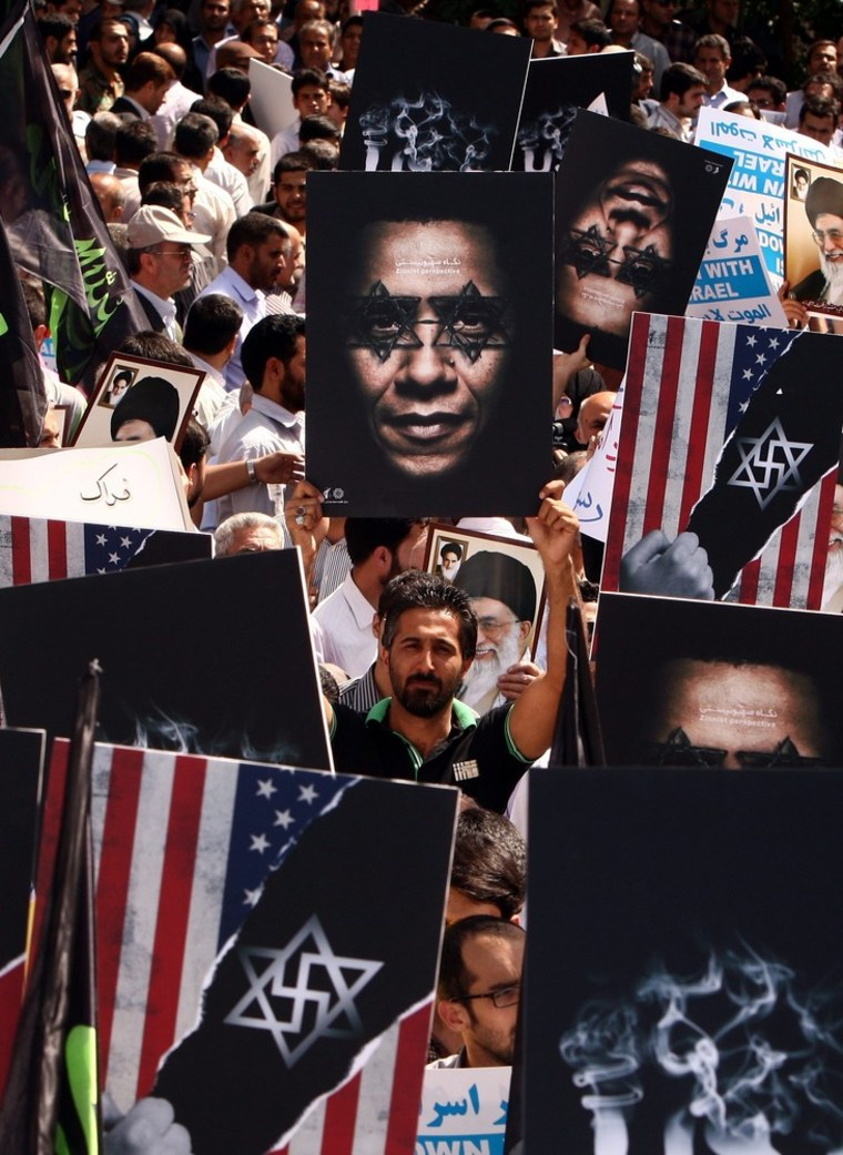 Image: Thousands of Iranian demonstrators take part during an anti-US and Israeli demonstration...