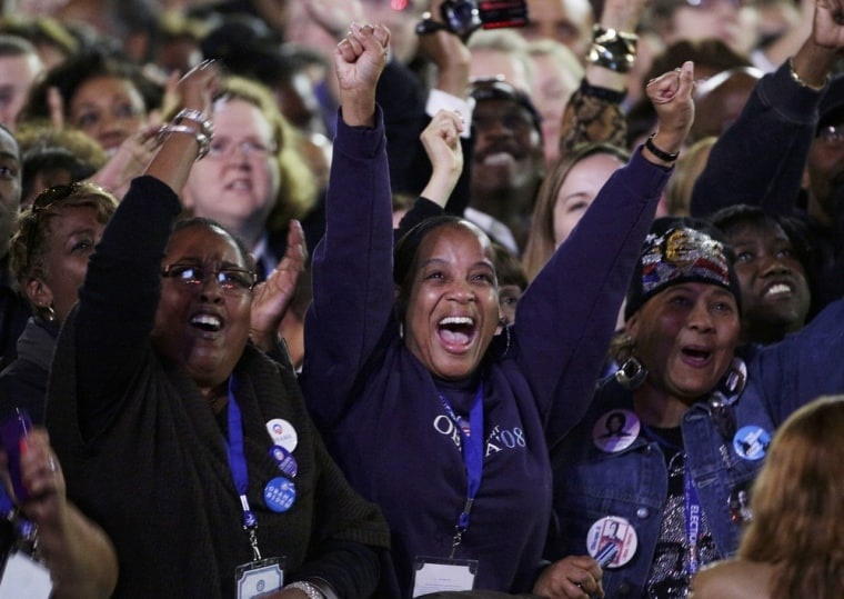 Image: U.S. President Barack Obama supporters cheer while watching the returns prior to his election night rally in Chicago