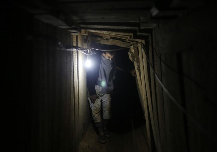 Image: Palestinian smuggler waits inside a smuggling tunnel dug beneath the Egyptian-Gaza border in the southern Gaza Strip