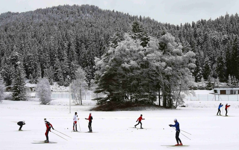Image: Cross country skiers ski on a track  in the western Austrian village of Seefeld