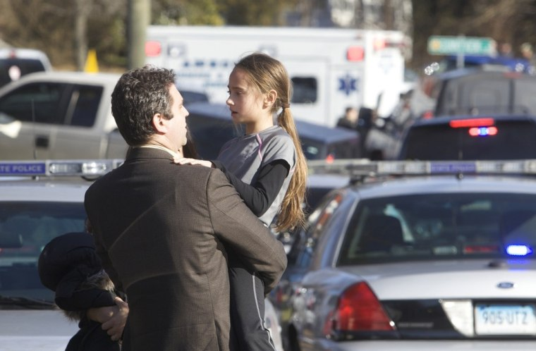 Image: Parents pick-up their children after a shooting at Sandy Hook Elementary School in Newtown