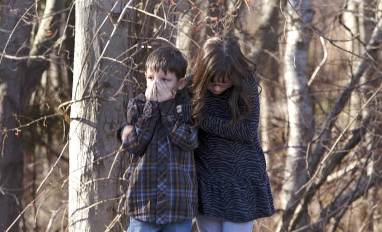 Image: Young children wait outside Sandy Hook Elementary School after a shooting in Newtown