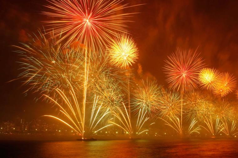 Image: Fireworks explode above Copacabana beach in Rio de Janeiro