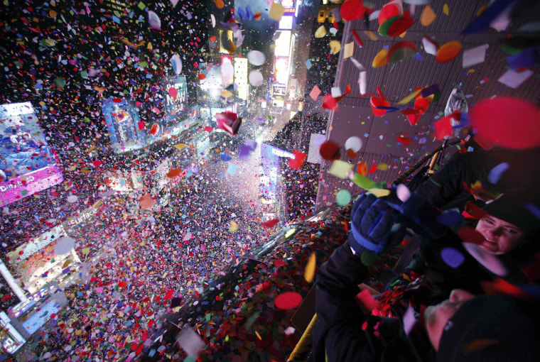 Image: Confetti is dropped on revelers at midnight during New Year celebrations in Times Square in New York