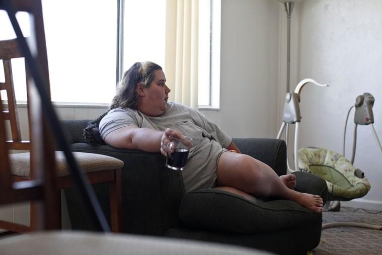 Image: Eason sits in side her Tucson, Arizona home