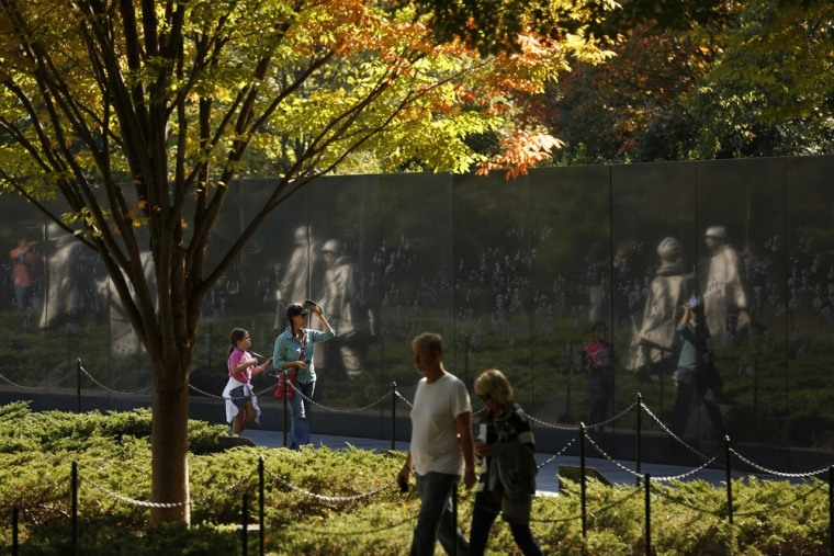 Image: Visitors walk through the Korean War Veterans Memorial after it was reopened to the public in Washington