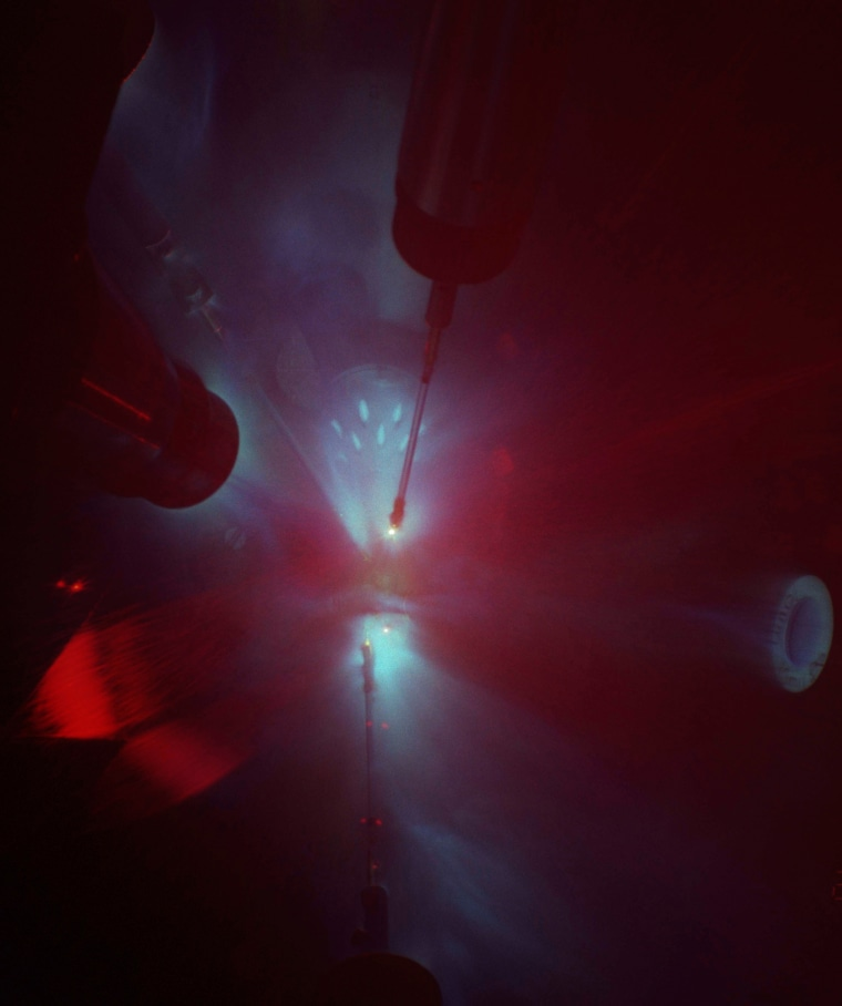 This image depicts a laser-shock experiment on Earth that recreated conditions deep within the planet as part of the study.