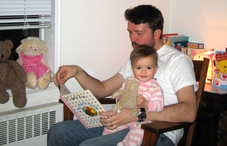 Image: Writer Alex Smith reads to his daughter Charlotte