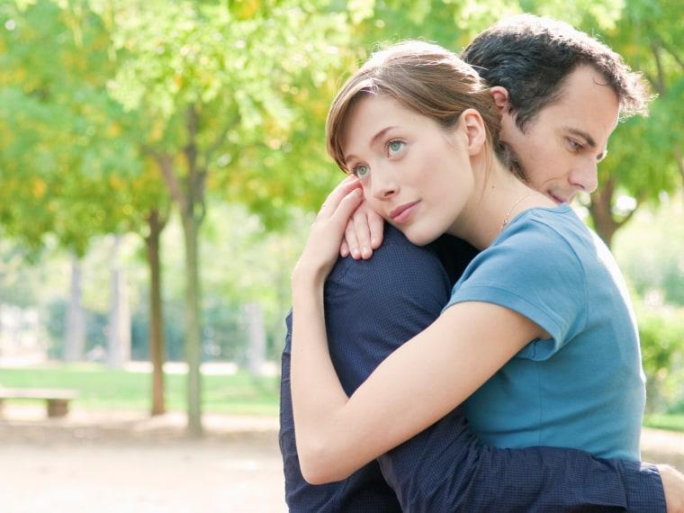 Couple embrace in park in Paris