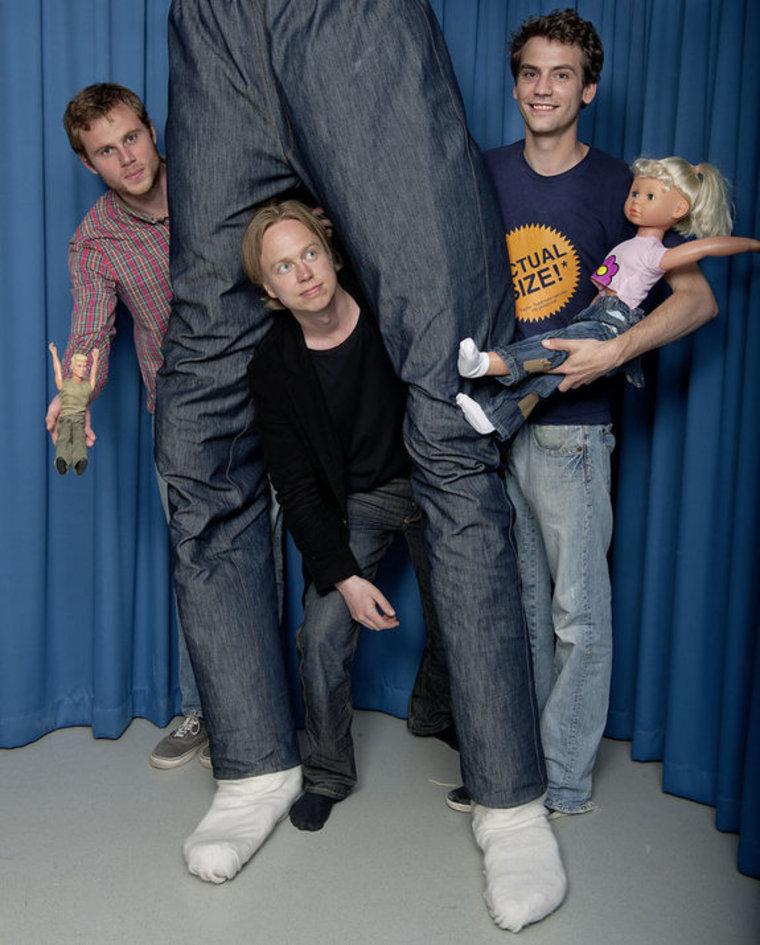 Karolinska Institute in Sweden (from left) Arvid Guterstam, Henrik Ehrsson and Björn van der Hoort pose with the tiny, medium-size and giant mannequins used in the study.