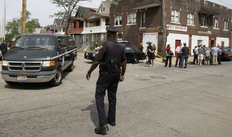 Image: A van with jurors leave the scene after visiting Anthony Sowell's home in Cleveland