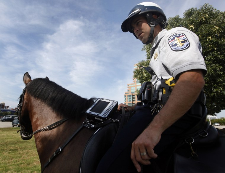Louisville Metro Police Department mounted patrol officers, Justin Hardy, and horse, Fury, carry computers on horseback that can check records, and other information that other officers in patrol cruisers can during traffic stops.