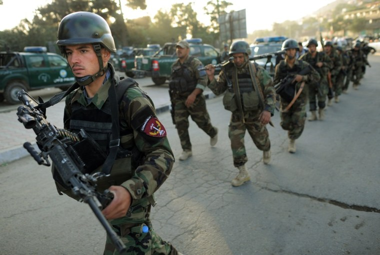 Image: Afghan soldiers walk towards the Intercontinental hotel