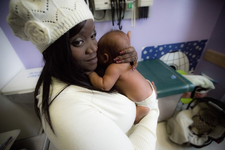 Image: Kayana Pearson, 29, and her child, Ammanuell