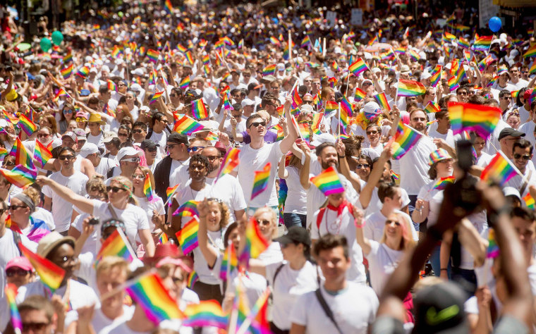 Image: Apple employees carry rainbow flags as they march in the San Francisco Gay Pride Festival in California