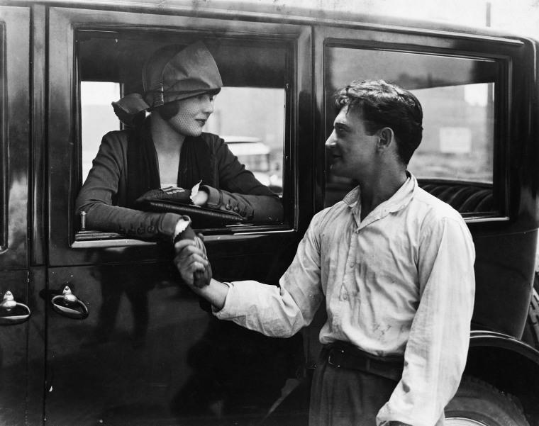 Man saying goodbye to woman in car (EV004170_H)