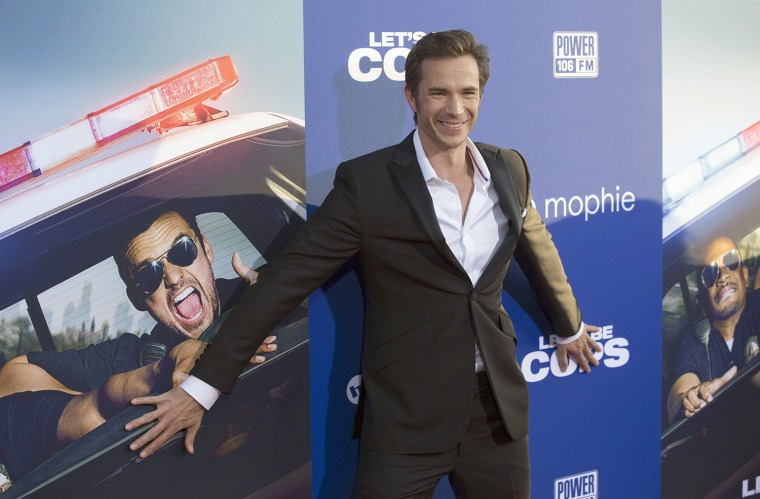 "Image: Cast member D'Arcy poses at the premiere of ""Let's Be Cops"" in Hollywood"