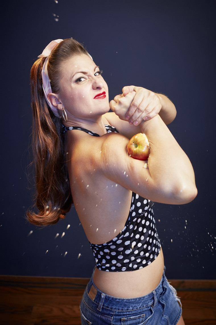 Linsey Lindberg - Most Apples Crushed With The Bicep  The most apples crushed with the bicep in one minute is 8 and was achieved by Linsey Lindberg from the USA on the set of 'Guinness World Records Unleashed' in Los Angeles, California.