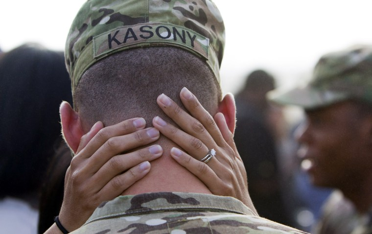 Image: rmy 2nd Lt. Brendan Kasony and his wife Joyce say their goodbyes