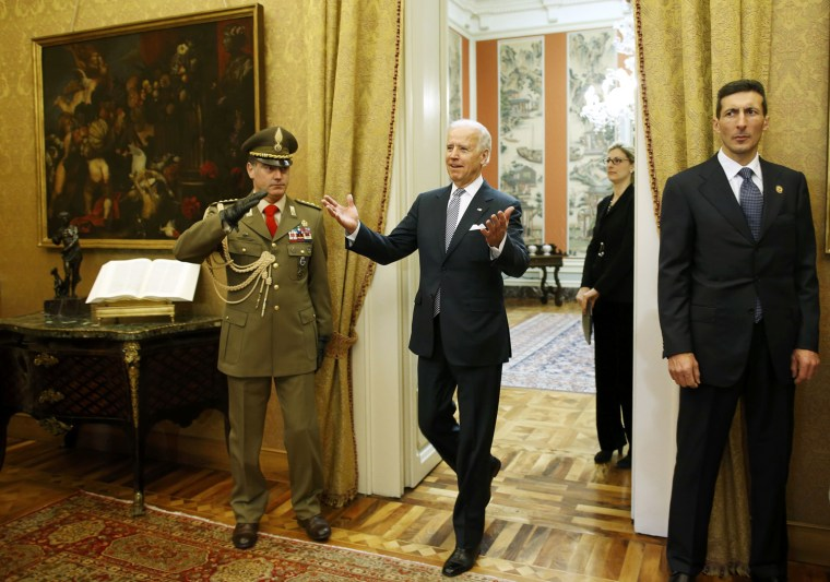 Image: U.S. Vice President Joe Biden gestures while entering to meet Italy's President Giorgio Napolitano at the Quirinale palace in Rome