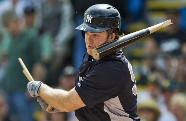Image: The barrel of Yankees' Boesch's broken bat smacks his face during their MLB spring training game against the Pirates in Bradenton, Florida