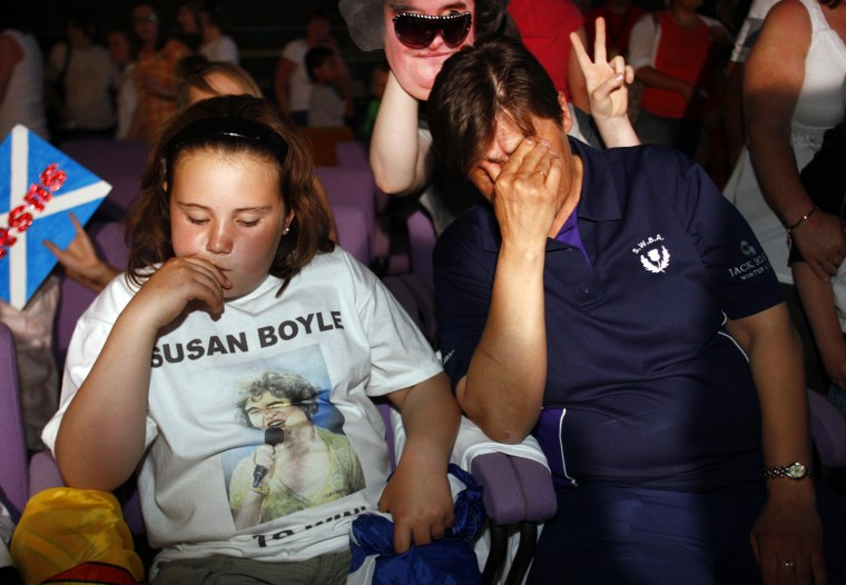 Fans of television show 'Britains Got Talent' singer Susan Boyle react in their local community centre in Blackburn, Scotland after it was announced that Boyle came second in the competition