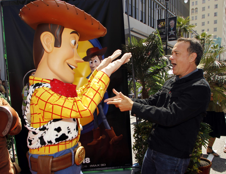 "Image: Actor Hanks greets the character Woody, whose voice he plays in the film, at the world premiere of Disney Pixar's ""Toy Story 3"" in Hollywood"