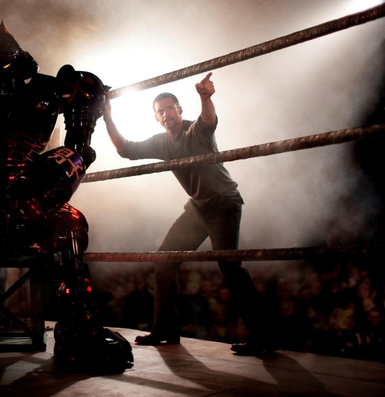 Hugh Jackman in Real Steel (2011)  Set in the near future, where robot boxing is a top sport, a struggling promoter feels he's found a champion in a discarded robot. During his hopeful rise to the top, he discovers he has an 11-year-old son who wants to know his father.