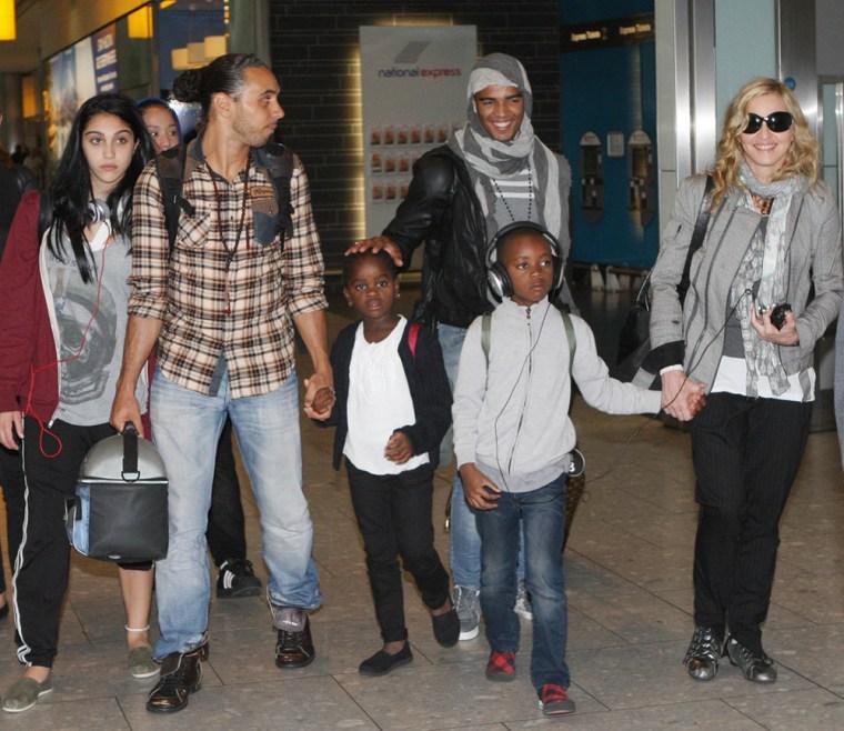 Madonna and Her Boyfriend arrive at Heathrow Airport.