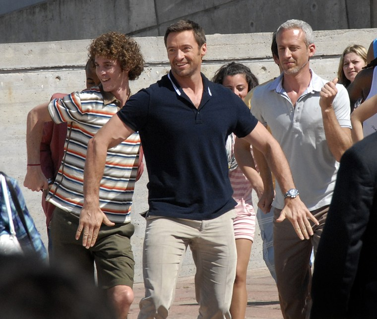 Australian actor Hugh Jackman (R) shoots
