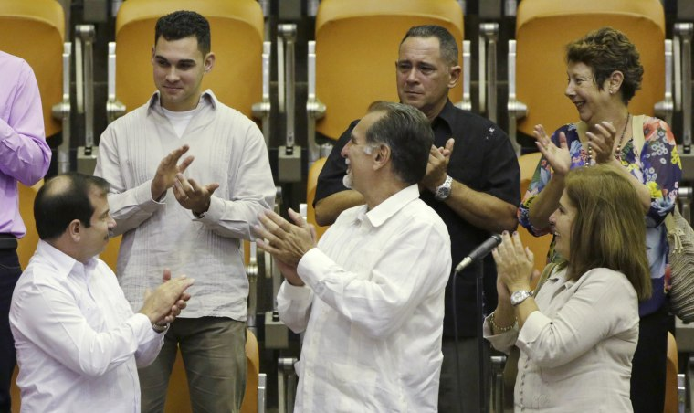 "Image: Cuban shipwreck survivor Elian Gonzalez stands with two of the so-called ""Cuban Five"" Fernando Gonzalez and Rene Gonzalez while attending the Cuban National Assembly in Havana"