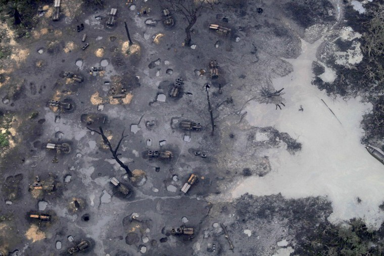 Image: A view of an illegal oil refinery is seen in Ogoniland outside Port Harcourt in Nigeria's Delta region