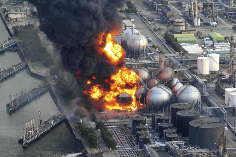 Image: Natural gas storage tanks burn at Cosmo oil refinery in Ichihara city