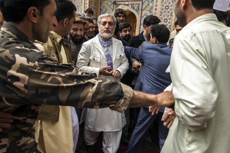 Image: Afghan presidential candidate Abdullah Abdullah visits the Khwaja Abd Allah Ansari shrine after his election campaign rally in Herat province