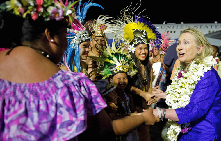 Image: U.S. Secretary of State Clinton participates in an arrival ceremony at Rarotonga International Airport in Rarotonga