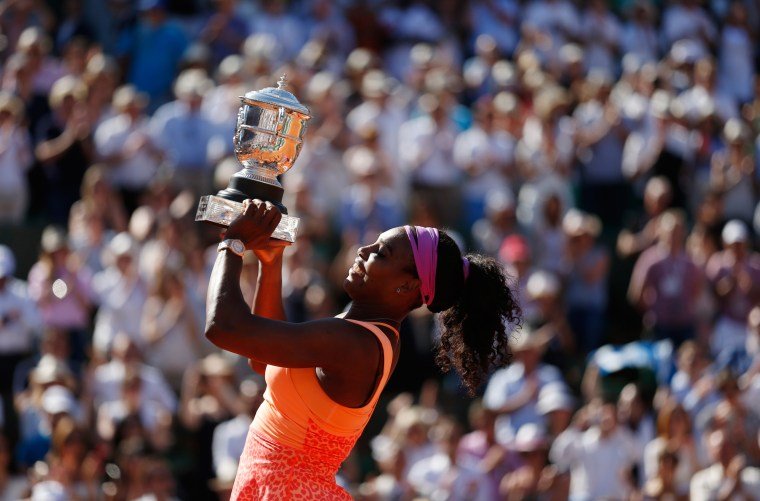 Serena Williams of the US poses with the trophy during the ceremony after defeating Lucie Safarova of the Czech Republic during their women's singles final match to win the French Open tennis tournament in Paris