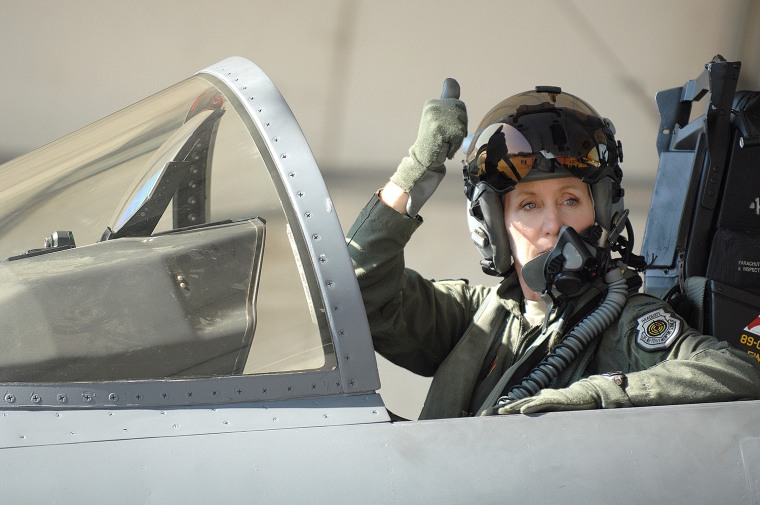 U.S Air Force Col. Jeannie Leavitt, 4th Fighter Wing commander, signals her crew chief before taking flight at Seymour Johnson Air Force Base, N.C., July 17, 2013.  After being stood down for more than three months, the 336th Fighter Squadron was finally given the green light to resume flying hours and return to combat mission ready status.  (U.S. Air Force photo by Airman 1st Class Brittain Crolley/Released)
