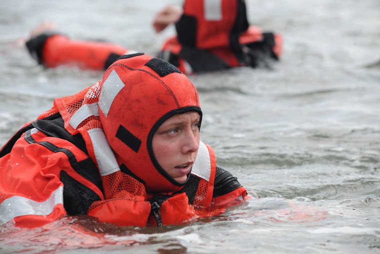 PORTSMOUTH, Va. - Seaman Sara Cook from Coast Guard Station Portsmouth participates in cold water survivor training at the station's pier, Oct. 26, 2012.   Cold water survival swim training is used to instruct the crew in proper survival techniques such as the Heat Escape Lessening Posture or the Group Conservation Posture.  U.S. Coast Guard photo by Petty Officer 3rd class David Weydert