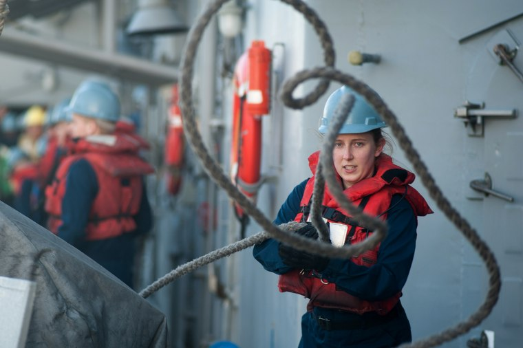 121218-N-LV331-059 ARABIAN SEA (Dec. 18, 2012) Sonar Technician (Surface) 3rd Class Jennifer Gonzales, from New Port Richey, Fla., hauls in excess line during a replenishment-at-sea aboard the Ticonderoga-class guided-missile cruiser USS Mobile Bay (CG 53). Mobile Bay is deployed with the John C. Stennis Carrier Strike Group to the U.S. 5th Fleet area of responsibility conducting maritime security operations, theater security cooperation efforts and support missions for Operation Enduring Freedom. (U.S. Navy photo by Mass Communication Specialist 2nd Class Armando Gonzales/Released)
