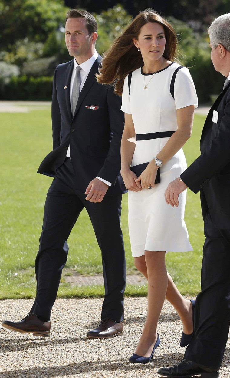 Image: Britain's Catherine Duchess of Cambridge is greeted by Olympic sailor Ben Ainslie as she arrives at the National Maritime Museum in London