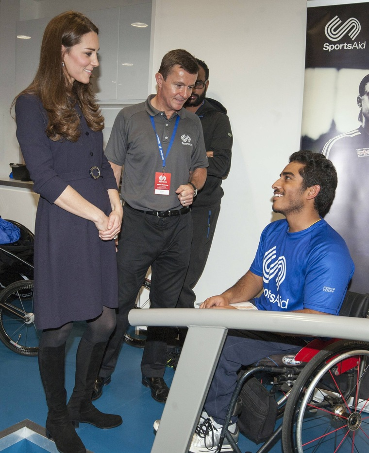 Image: Britain's Catherine, Duchess of Cambridge speaks with a wheelchair athlete during her visit to a SportsAid workshop at the GSK Human Performance Laboratory in London