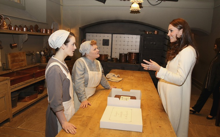 Image: Britain's Catherine, Duchess of Cambridge chats to actresses Sophie McShera and Lesley Nicol during a visit to the set of Downton Abbey at Ealing Studios, west London