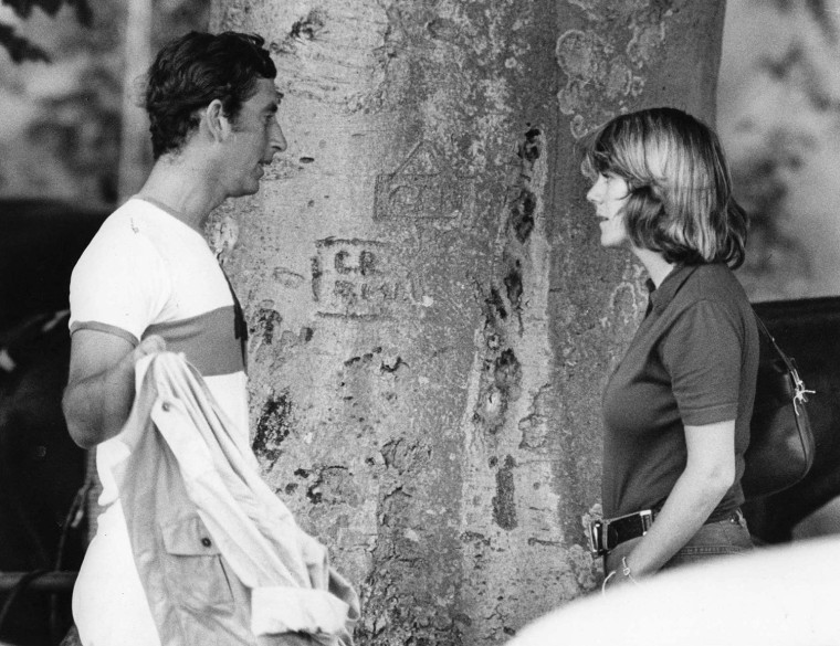 Prince Charles, then 26, chats to Camilla Parker Bowles, his future wife, at a polo match in July 1975. He first met her four years earlier at a polo match at Windsor. They shared many interests, including a love of horses, polo and country pursuits. Camilla had married the cavalry officer Andrew Parker Bowles in 1973.