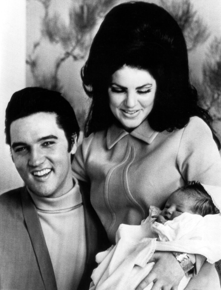 ELVIS PRESLEY, PRISCILLA PRESLEY and LISA MARIE PRESLEY prepare to leave hospital, 2/5/68
