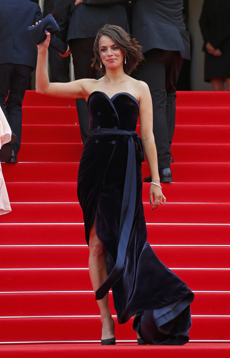 """Image: Cast member Berenice Bejo poses on the red carpet as she arrives for the screening of the film """"The Search"""" in competition at the 67th Cannes Film Festival in Cannes"""
