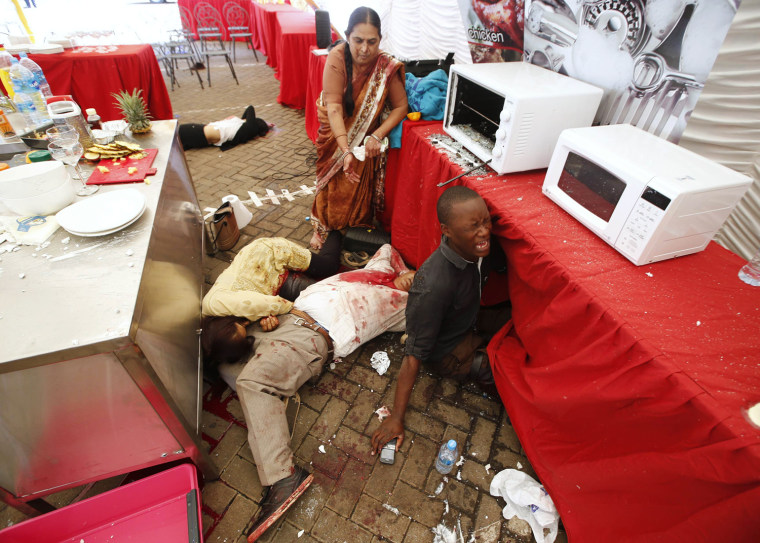 Image: Injured people cry for help after gunmen went on a shooting spree in a shopping centre in Nairobi