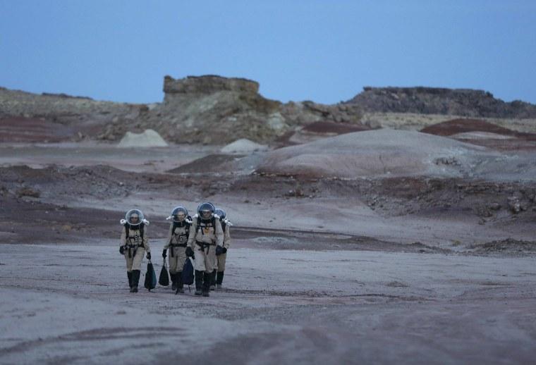 Image: Members of Crew 125 EuroMoonMars B mission return after collecting geologic samples in the Utah desert